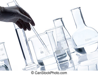 Group of glass flasks with a clear liquid
