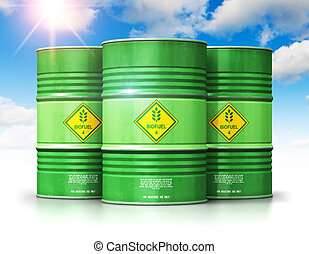 Group of green biofuel drums against blue sky with clouds...