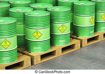 Group of green biofuel drums on shipping pallets in the storage warehouse