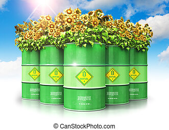 Group of green biofuel drums with sunflowers against blue sky with clouds