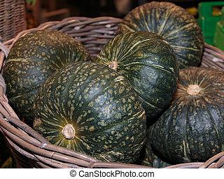 Group of Green Pumpkins inside Wicker Box
