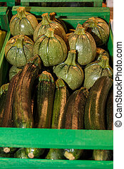 Group of Green Zucchini inside Wooden Box, Courgette