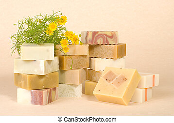 group of handmade soap with herbal material, soap stack.