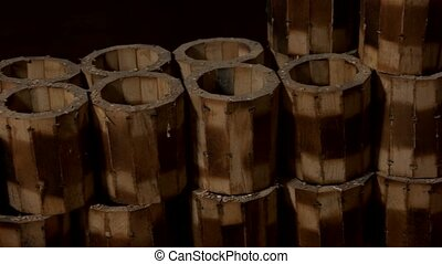 Group of handmade wooden mugs at workshop.