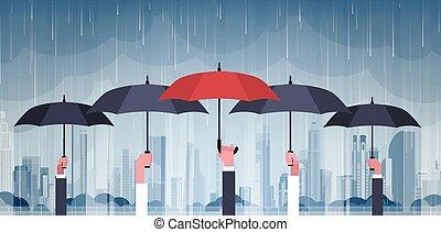 Group Of Hands Holding Umbrellas Over Storm In City Huge...