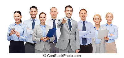 group of happy business people pointing at you - business,...