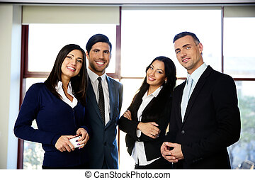 Group of happy business people standing in the office