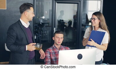 Group of happy business people working together, brainstorming in office.