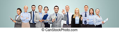 group of happy businesspeople with dollar money
