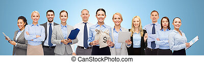 group of happy businesspeople with money bags - business,...