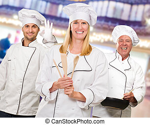 Group Of Happy Chef's At Work
