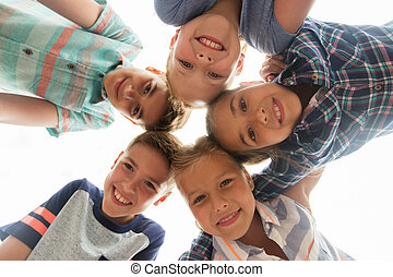 group of happy children faces in circle - childhood,...