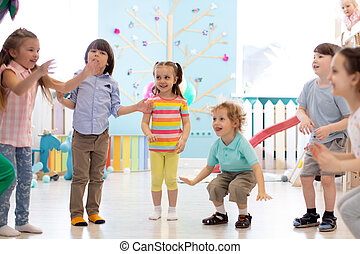 Group of happy children jump indoor. Kids play together