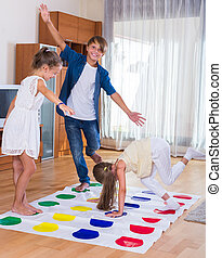 children playing at twister