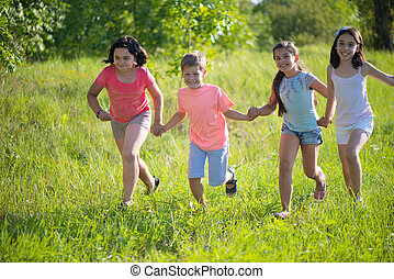 Group of happy children playing
