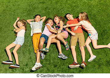 Group of happy children playing outdoors.