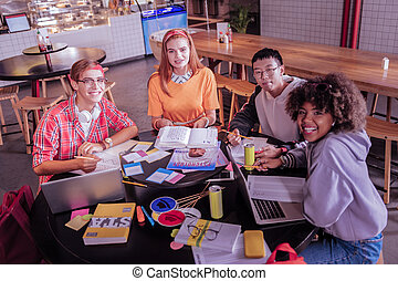 Group of happy classmates that studying together