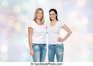 group of happy different women in white t-shirts
