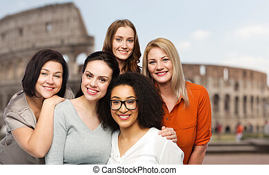group of happy different women over coliseum - friendship,...
