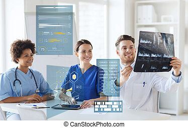 group of happy doctors looking at x-ray image