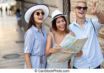 Group of happy friends enjoying sightseeing tour in the city.
