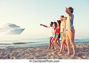 Group of happy friends having fun at ocean beach. Travel...