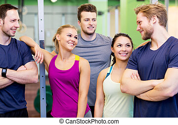 group of happy friends in gym