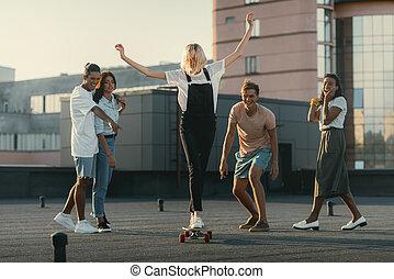 girl riding skateboard on roof