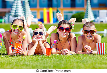 group of happy friends on summer lawn