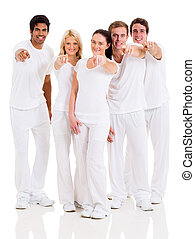 group of happy friends pointing
