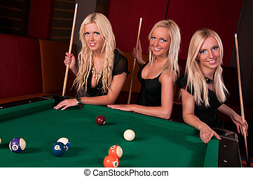Group of happy girls playing in billiard