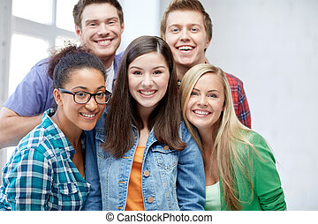 group of happy high school students or classmates -...