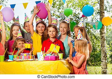 Group of happy kids celebrating birthday outdoor