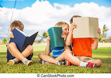 Kids Reading Books - Group of Happy Kids Reading Books ...