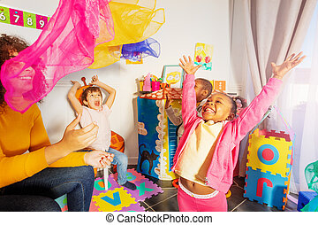 Group of happy laughing kids throw handkerchief