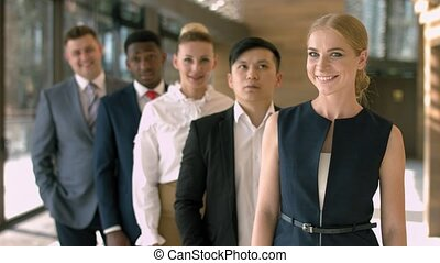 Group of happy multiracial businesspeople standing in row