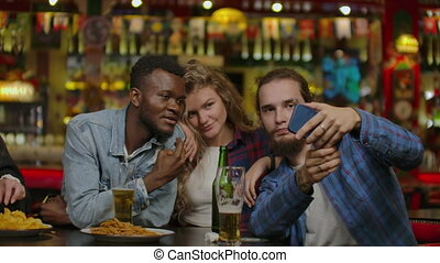 Group Of Happy Multiracial Friends Making A Toast With Beer At Bar Or Pub