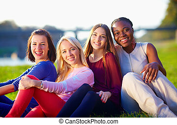 group of happy multiracial friends, outdoors