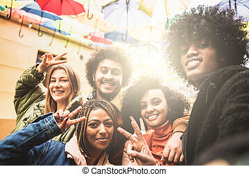 Group of happy multiracial friends taking selfie for social media.
