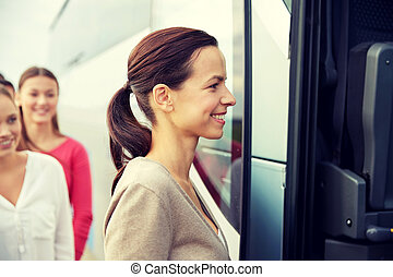 group of happy passengers boarding travel bus