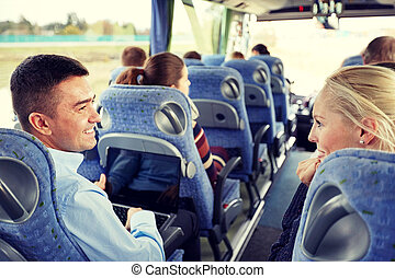 group of happy passengers in travel bus - transport,...