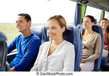 group of happy passengers in travel bus
