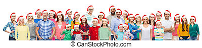 group of happy people in santa hats - diversity, christmas...
