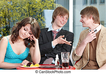 Group of happy people talking in cafe.