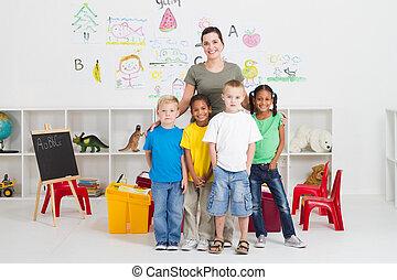 preschool kids and teacher - group of happy preschool kids...