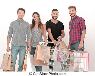 group of happy shoppers with shopping bags