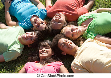 group of happy smiling diverse kids at summer camp