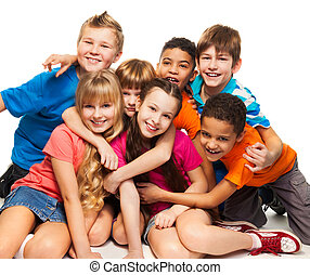 Group of happy smiling kids sitting together and playing -...