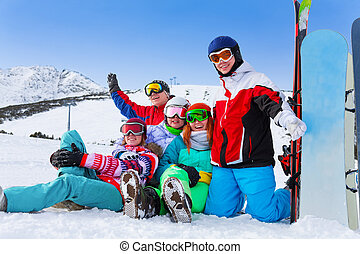 Group of happy snowboarders in the mountains