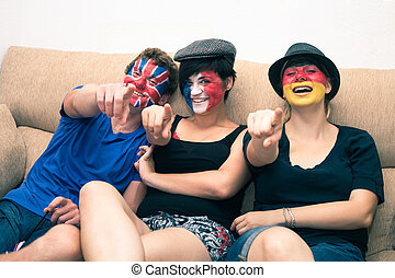 Group of happy sports fans pointing